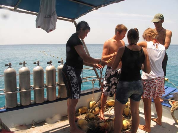 Volunteers check their gear before diving at Thai Island Dream Marine Conservation
