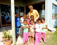 A volunteer helps children of the Wild Coast in South Africa